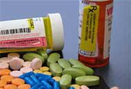 Photo of medication bottles and pills