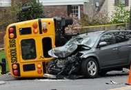 Photo of a car and bus accident