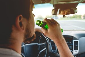 Picture of man drinking and driving