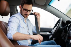 Picture of man buckling seatbelt