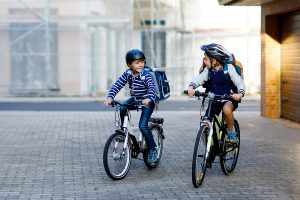 Picture of two school boys on bicycles